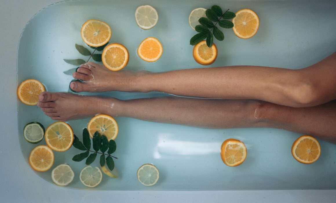 legs-in-bath-with-orange-slices