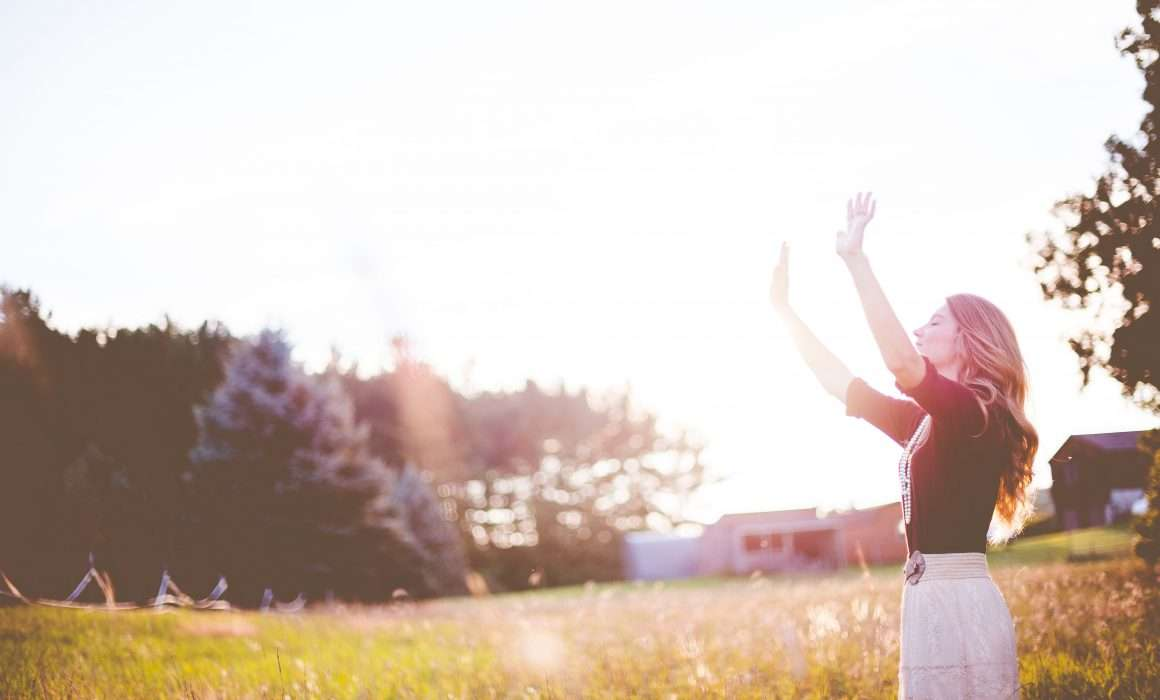 woman-lifting-arms-to-the-sky-in-gratitude