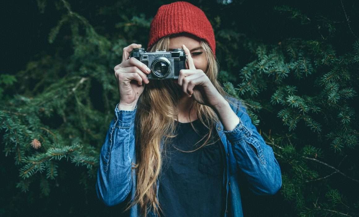 woman-holding-camera-up-to-eye