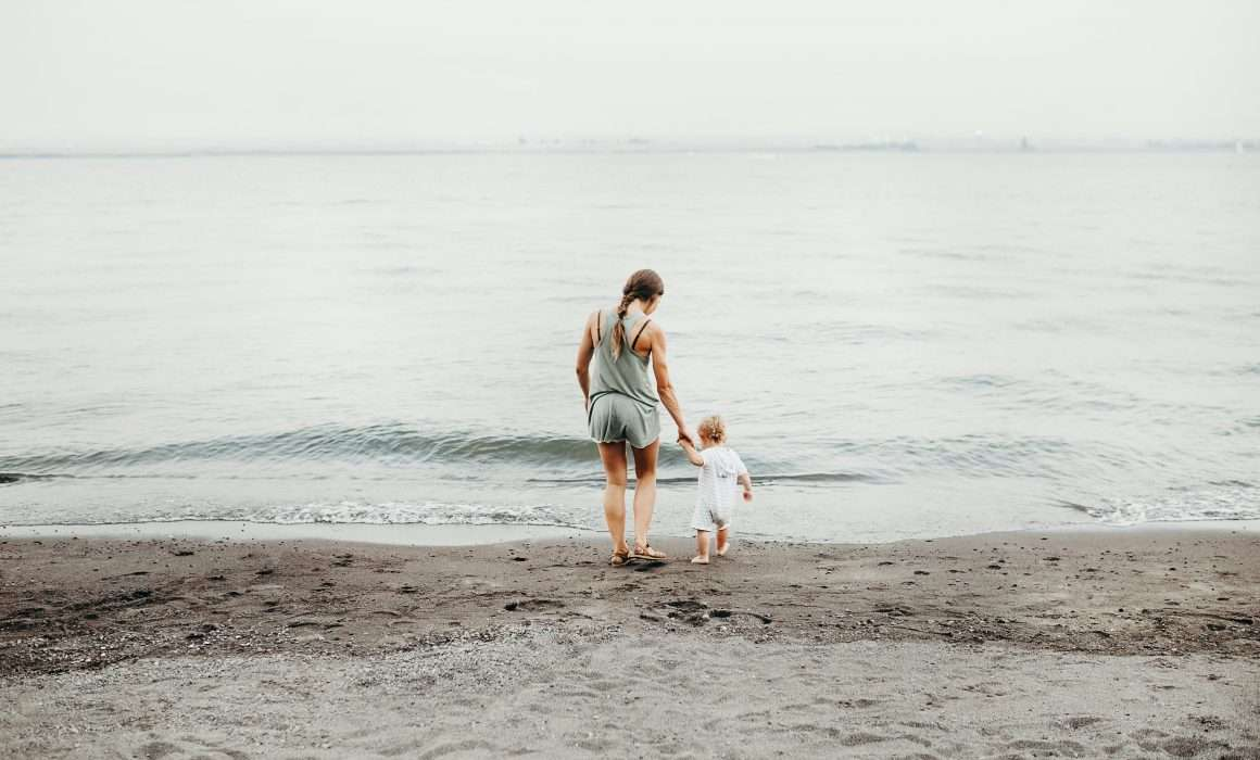 woman-and-baby-by-the-seaside