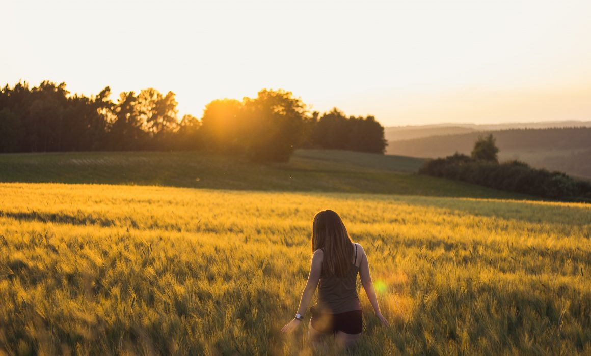walking-in-field-at-sunset