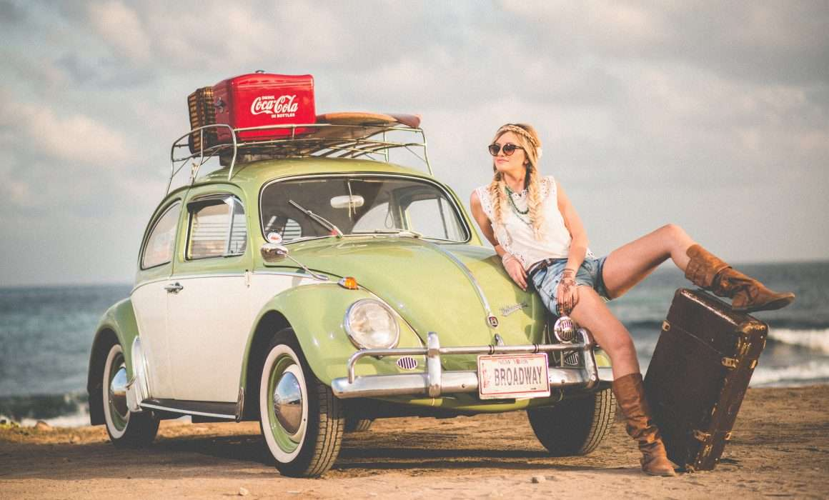 travel-and-personal-growth-woman-by-mini-car