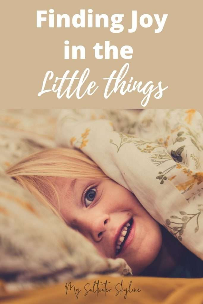 finding-joy-in-the-little-things-girl-peeping-out-from-under-duvet-pin