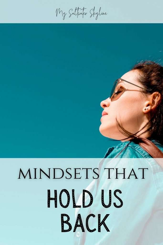 woman-looking-up-at-blue-sky-mindsets-that-hold-us-back-blog-post