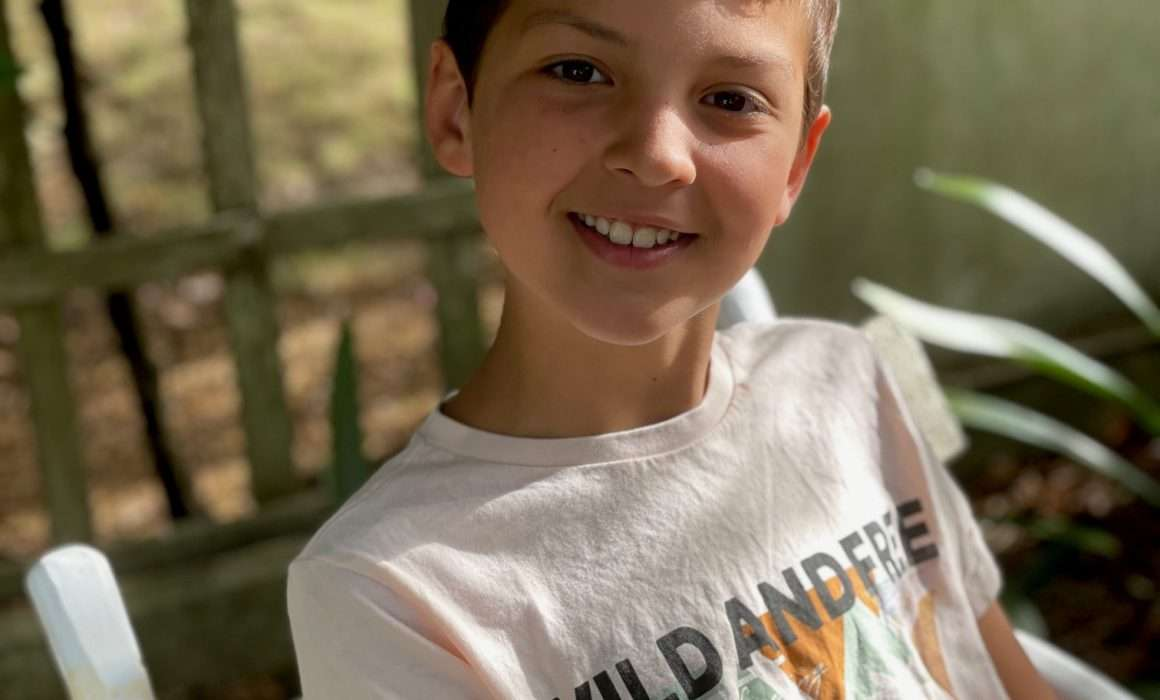 young-boy-happy-smile-healthy-after-illness-strength-through-pain-blog-post