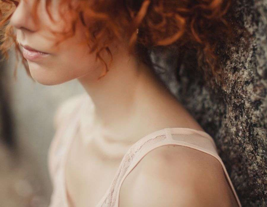 close-up-bottom-half-of-womans-face-sad-expression-curly-red-hair-forgiving-yourself-blog-post